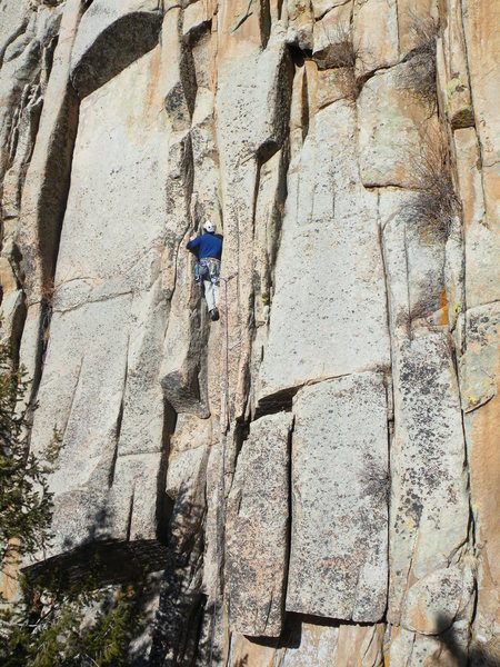 Mike Caputo climbing the bottom of the route. Oh Wilbur climbs the beautiful dihedral on the left side of the slab.