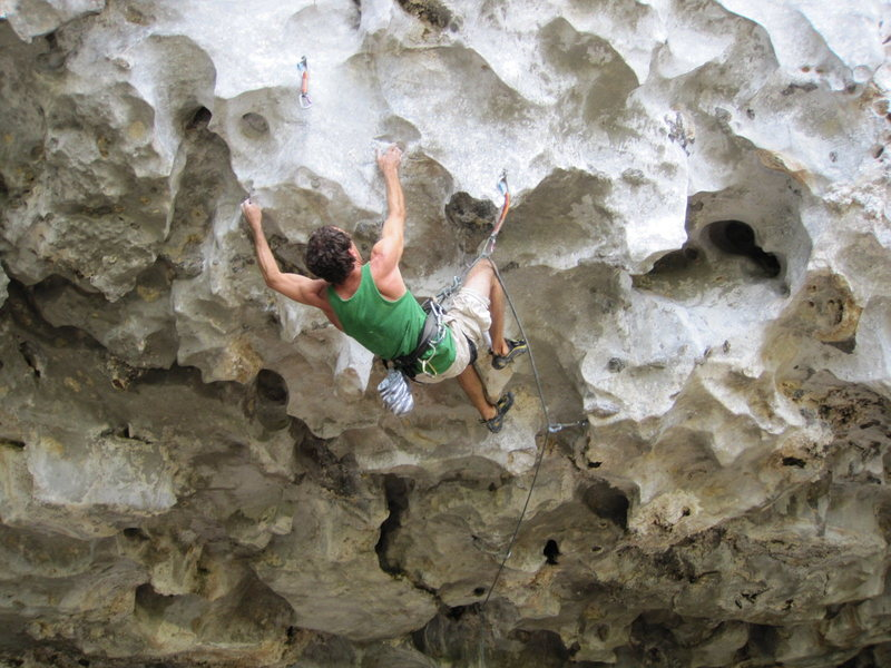 Glen C working Cicak, 7c+. Fairy Caves, Borneo.