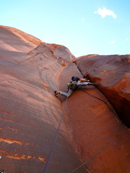 Climbing the top pitch of the left route.