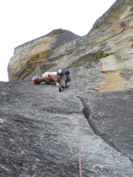Almost there! Taking advantage of good knee jams at the top of pitch 3.<br> <br>