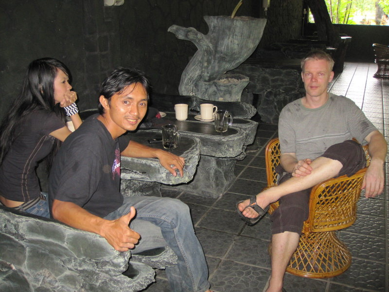Alex, Noh, and his Malay girlfriend at the bar in front of the limestone cliffs. Bau region, Sarawak, Malaysia.