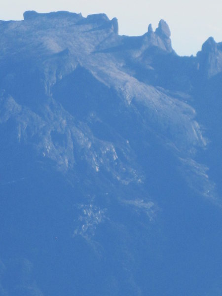 Mount Kinabalu summit plateau. Numerous climbing lines on granite spires. Noone ever climbs them.