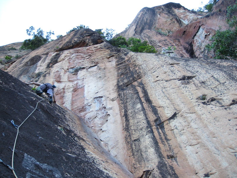 Scary run-out slab route. locals cut first bolts for metal. Berhala Island, Sabah.