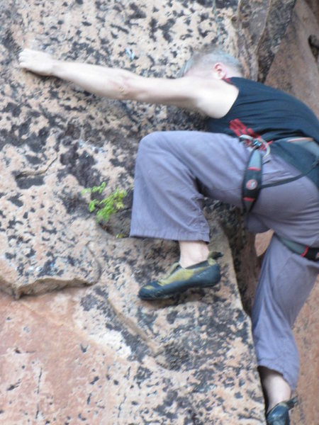 Rock Climbing Photo: Alex working an arete route, hard 5.11. Berhala Is...