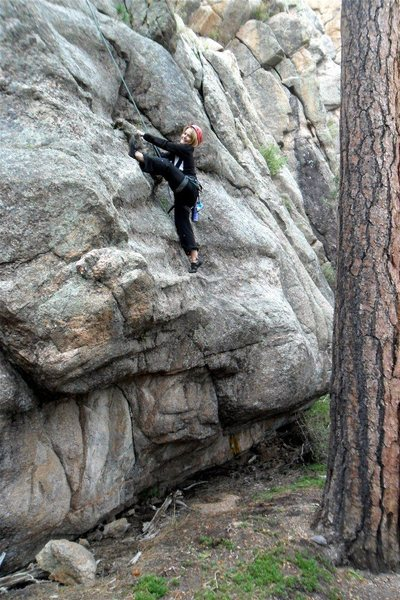 "Brenda having fun just above the crux start of ""Anything but the Fast Lane""."