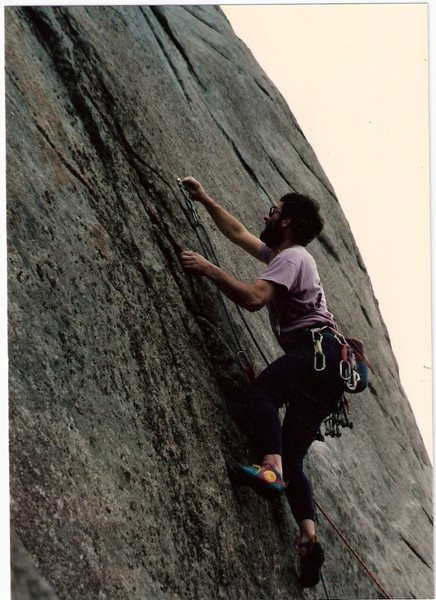Eddie Begoon tightens the first bolt on Direct start to Hyperbola,Sea of Brows by The Waste Side & The  1988.