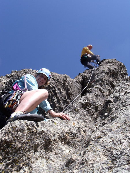 Paul Huebner belaying Anne Meyer up the short East Summit Pitch. (Photo by Lenore Sobota)