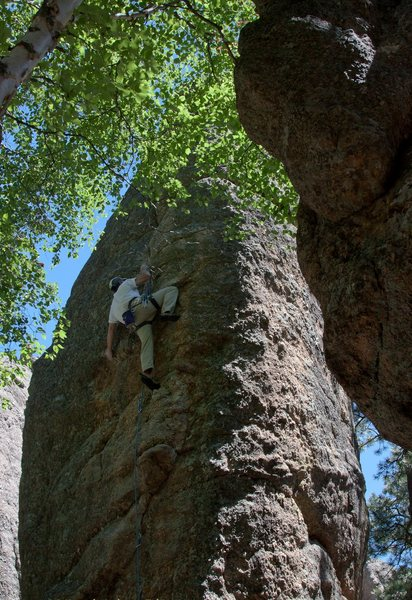 Gearing up for the crux on End Pin. <br> <br> Photo:  Dennis Laughlin