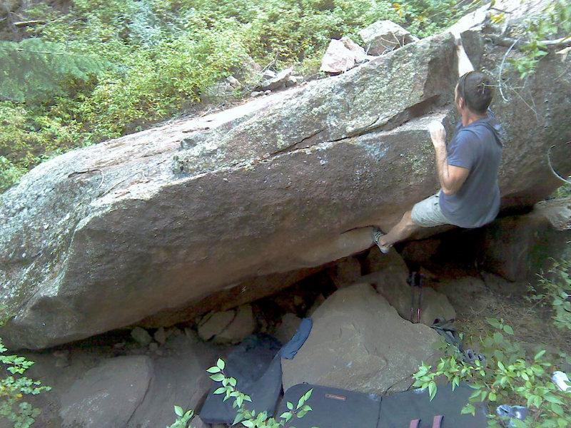 Jon climbs the rock.