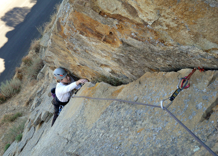 """A fun variation to The Good, the Bad & the Ugly is to climb the first 6 bolts of that route and then veer right upon reaching the overhang.  It is possible to follow a right-arching hand crack up to the top of the wall.  <br> <br> The crux of this variation involves delicate smearing with a cam below your feet.  Carry two pieces in the 1/2"""" to 1"""" range.  Rappel from bolts."""