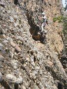 Rock Climbing Photo: Up the black streak past the big hole