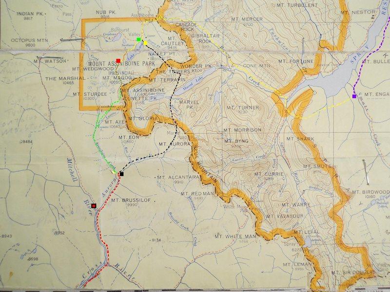 Trail Map<br> Mount Assiniboine<br> contour interval 200 feet<br> <br> red box - Hind Hut<br> yellow - Assiniboine Lodge<br> green box - Magog Lk Camp<br> violet box - Shark Mtn TH<br> black box - Marvel Pass TH<br> black/red box - Baymag<br> <br> yellow dash - Bryant Cr Tr<br> yellow/red - Gmoser's Hwy<br> yellow/black - N Ridge<br> green - Assiniboine Cr Tr<br> black dash - Marvel/Wonder <br> <br>