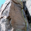 """The bolted arete, marked 11b, is the """"Direct Start to Missing Link.""""(a.k.a. Java Man)  Look right at the liebacking crack which is the start.  The rest of the route is behind the tower and out of sight."""