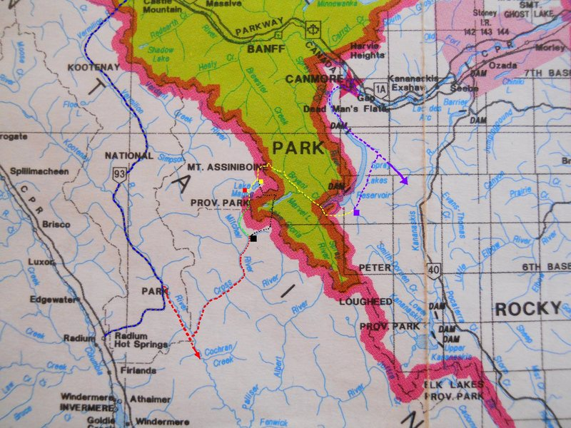 ASSINIBOINE APPROACHES<br> 10 km grid<br> <br> red box - Hind Hut<br> yellow - Assiniboine Lodge<br> violet - Shark Mtn TH/LZ<br> black - Marvel Pass<br> <br> red dash - Settlers rd, BC<br> violet dash - Spray lakes rd<br> yellow dash - Bryant/N Ridge<br> green dash - SW Face