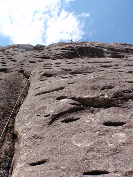 Rock Climbing Photo: Drilling the bolt in the final crux.