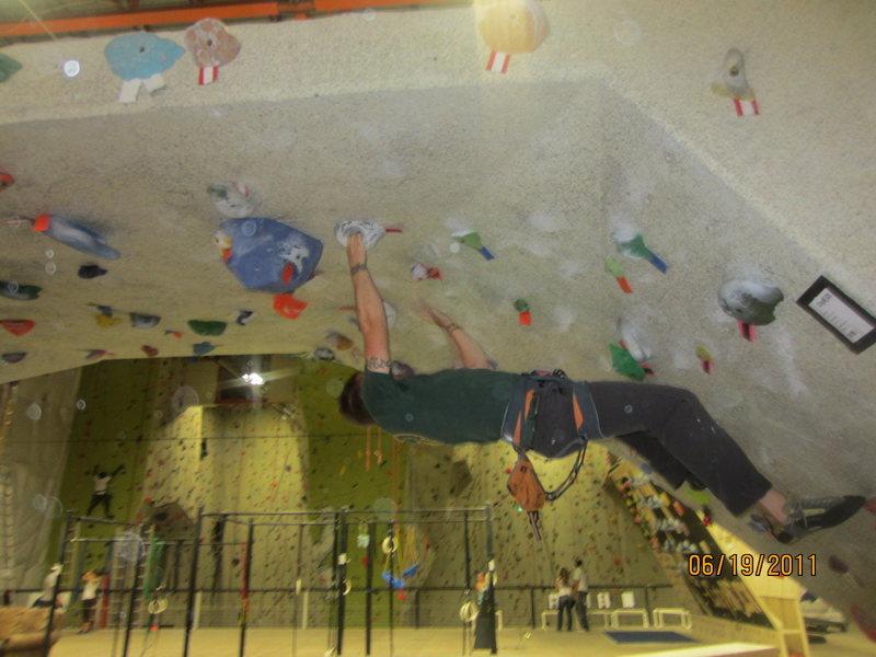 city rock gym <br> boulder wall w big wall in background