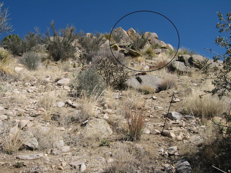 Photo was taken at a switchback and is about as close as the trail gets to the destination.  The practice area is at the base of the circled formation, out of sight around to the right.