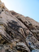 Rock Climbing Photo: Kindergarten Cop goes up the black slabby face in ...