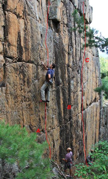 Vertical Wall <br> A - Original Route, 5.10-.<br> B - The Yardstick, 5.11+,<br>    (up the black streak).<br> C - Clear Cut, 5.10 (orange rock & crack).