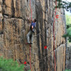 Vertical Wall <br> A - Original Route, 5.10-.<br> B - The Yardstick, 5.11+,<br>    (up the black streak).<br> C - Clear Cut, 5.10 (orange rock & crack).