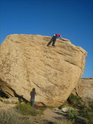 Rock Climbing Photo: topping out on slashface V3R.