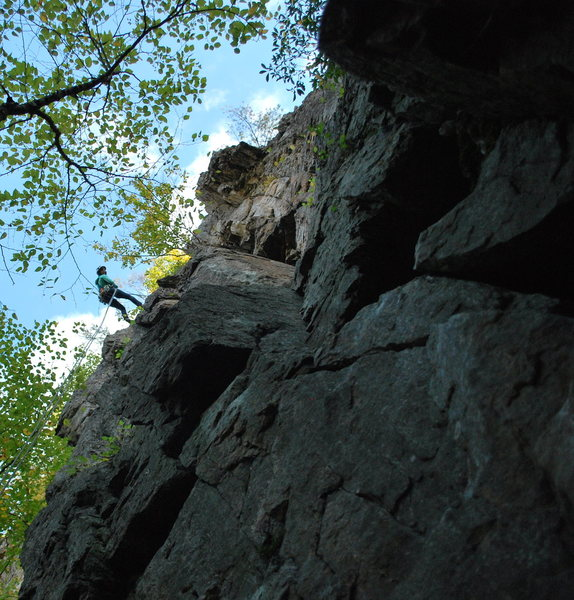 Tammy rapping off F.o.F.  <br> <br> Climb starts at the obvious broken face in pic, climb to roof, traverses roof to the left, then follow obvious cracks to tree and ledge.
