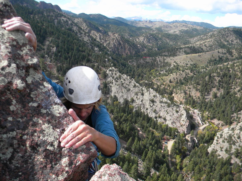 Rock Climbing Photo: Laurie topping out on the route. Great position.