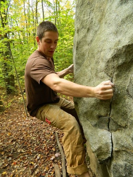 Matt Wallace setting up for the crux<br> <br> Photo Rebecca Eytel