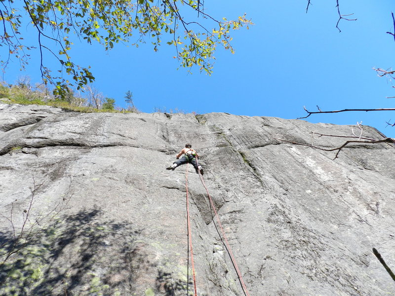 Climbing the first pitch on the FA