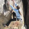 McKenzie Skiles on the boulder problem start.
