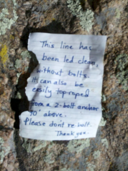 This polite, well written note from ? Bolt Chopper seen at base 10/10/11.  Bolts gone and holes reclaimed.