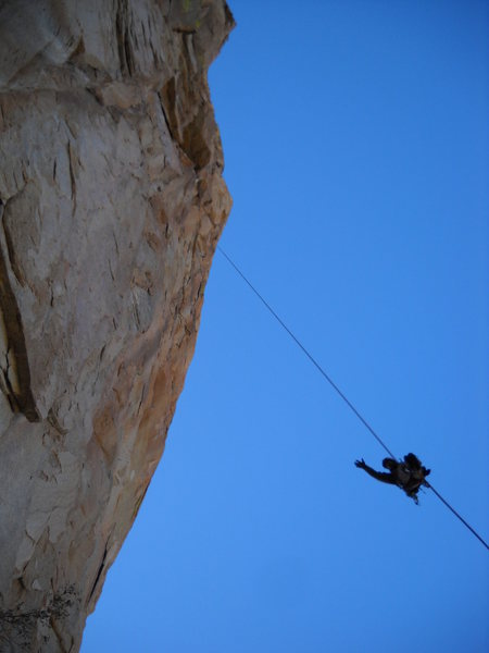 Climber rappelling from the top of pitch 2.  Note the amount of overhang.