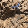 Ed moves past the crux roof & gets ready for the tough corner<br> Clovis Hunter (5.12)