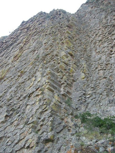 &quot;Unfortunately, the most aesthetically appealing line (to me) doesn't appear climbable - we didn't see anywhere to place gear on this neat face. If you managed to get up it, you would have to do a bit of a 4+ scramble up loose garbage to get to the rap station/NE saddle, and thence on to the summit.&quot;<br> - Jeremy Hakes<br> photo & description: Summitpost