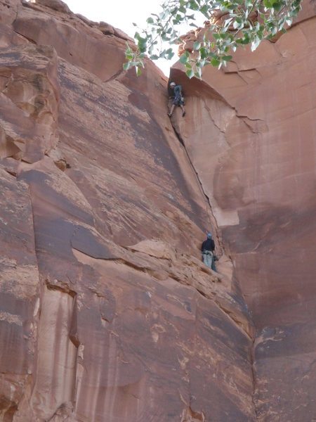 Belaying belaying below the last bolt, Mike Keegan leading the dihedral