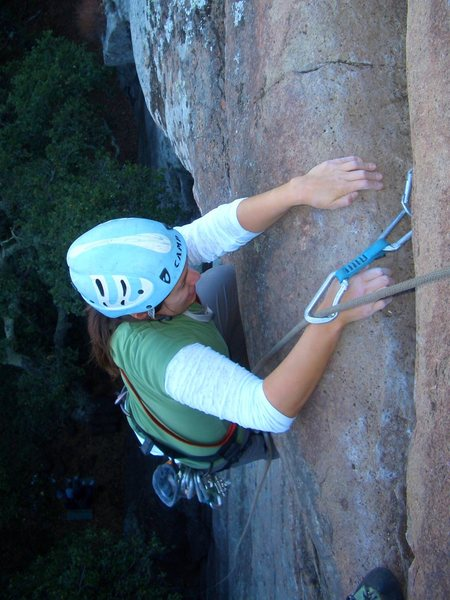 Cheri Ermshar pulling the crux overhang on Mouse Maze 5.9. Note the smooth hand holds. Photo by Floyd Hayes.