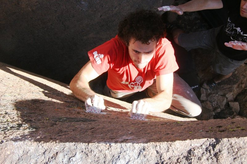 Rock Climbing Photo: Crimp hard and reach - how far is that lip?