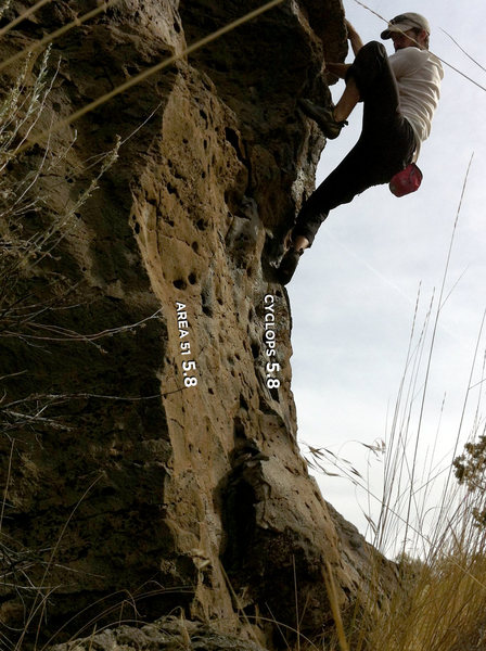 Working feet up, getting ready to reach up to big holds to pull up & over the roof/bulge. One of the few overhanging, though for just one move, at The Drive In. Fun, quick problem.