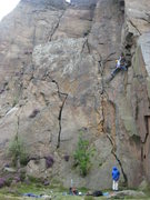 Rock Climbing Photo: Inspecting the crux layback from a wide bridging p...