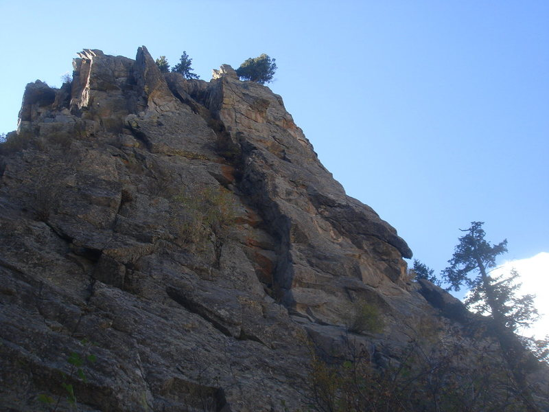 East face of Sport Land.  Toe the Line follows the prominent arete in the center of the photo.
