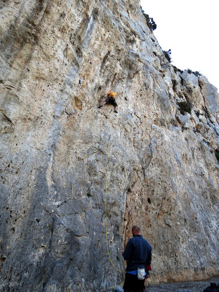 Your Top Rope Hero cruxing out on greasy phantom edges high above his last clip...his partner Sean asleep at the belay.