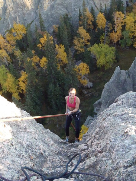 Catherine rappelling down a spire.