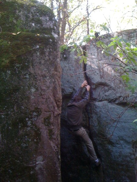 Im climbing the warmup crack in the pit. Pinball arete should be in the left of the photo.<br> <br> Photo: Paul Campbell