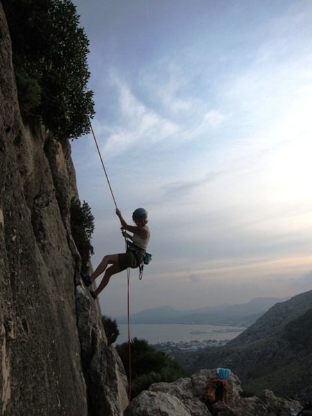 Rappelling off Curset at La Creveta with Port de Pollença in the background.