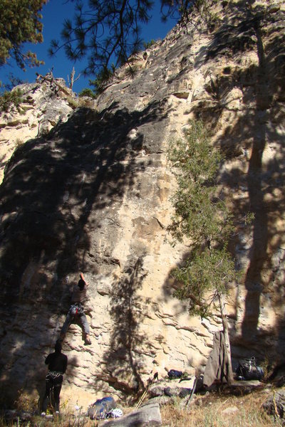 Climber on Red Hooks For Red Eyes, 5.10a<br> <br> Light Bulb Buttress, Sunshine Wall.<br> <br> Spearfish Canyon, South Dakota.