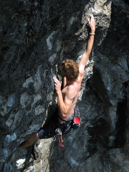 In the crux -The Oppurtunist, unknown climber<br> <br> Lots of nice air below at this point