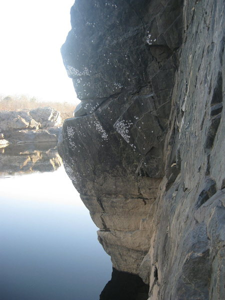 Crux 2nd pitch (5.9).  Moving out left over water and onto ledge for belay.
