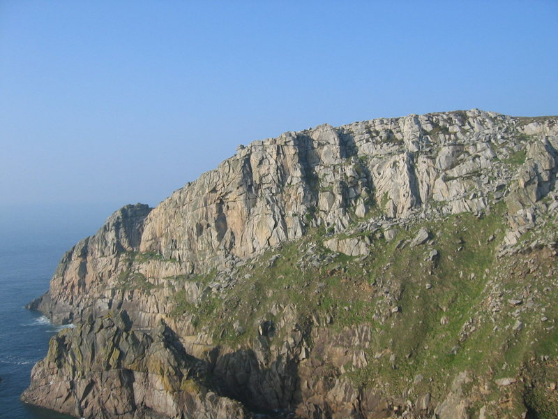 The Main Face at Bosigran is the upper cliff, well out of reach of the sea (photo by Phil Ashton)