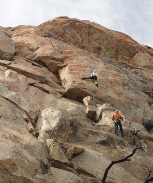 Climber is just just past a crux on P2 of Unfinished Business.  The headwall looms above.<br> <br> Photo by Chris Hubbard.