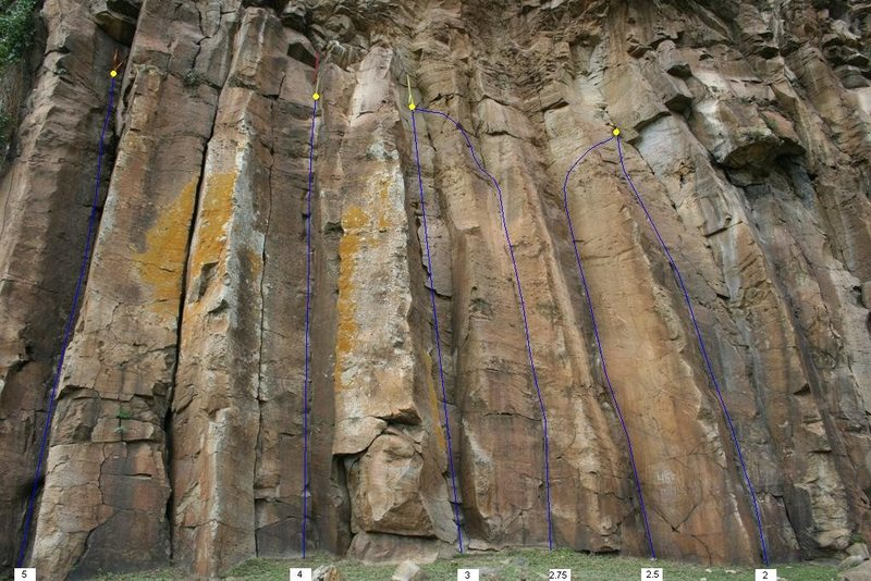The rightmost series of routes on the cliff